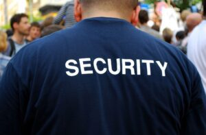 security guard in front of a crowd of people